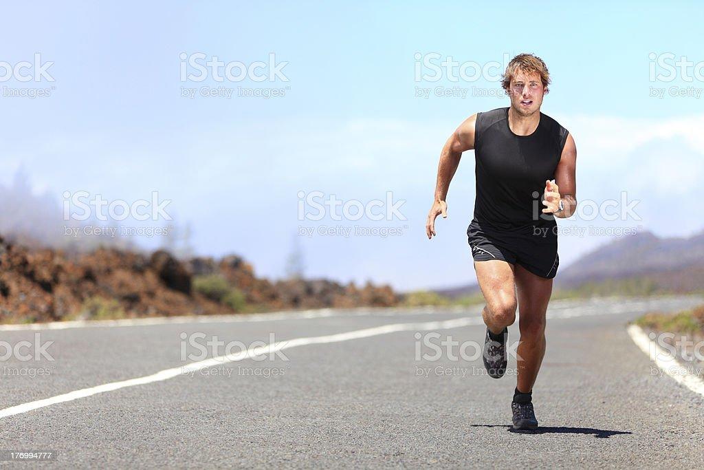 Man running / sprinting on road royalty-free stock photo