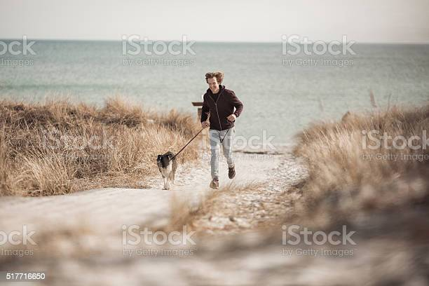 Man running with his dog picture id517716650?b=1&k=6&m=517716650&s=612x612&h=qgz vv0j9cliyxck7vbcgodqy4gqgfs2wegqiewvyj0=