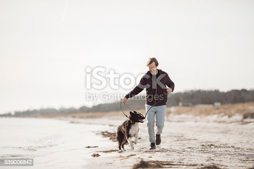 istock Man running with his dog 539006842