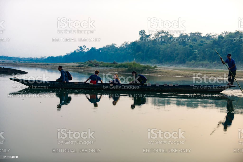 Man Runs A Wooden Boat On The River Nepal Chitwan National Park