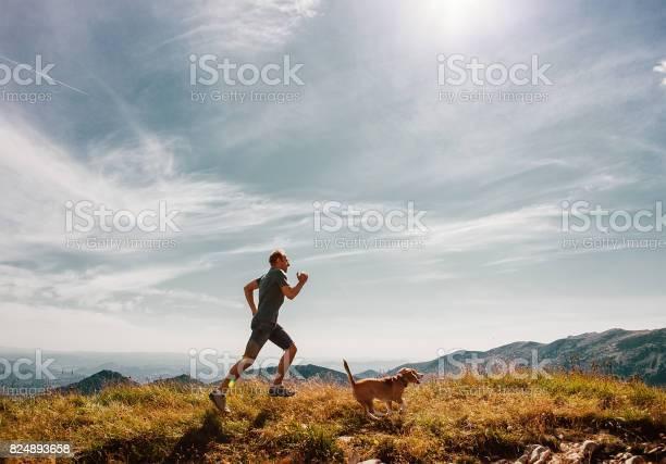 Man runs with his beagle dog on mountain top picture id824893658?b=1&k=6&m=824893658&s=612x612&h= ysrz zb8hyavga7qtaywxu6gg9vvddhzqu dqiz vy=