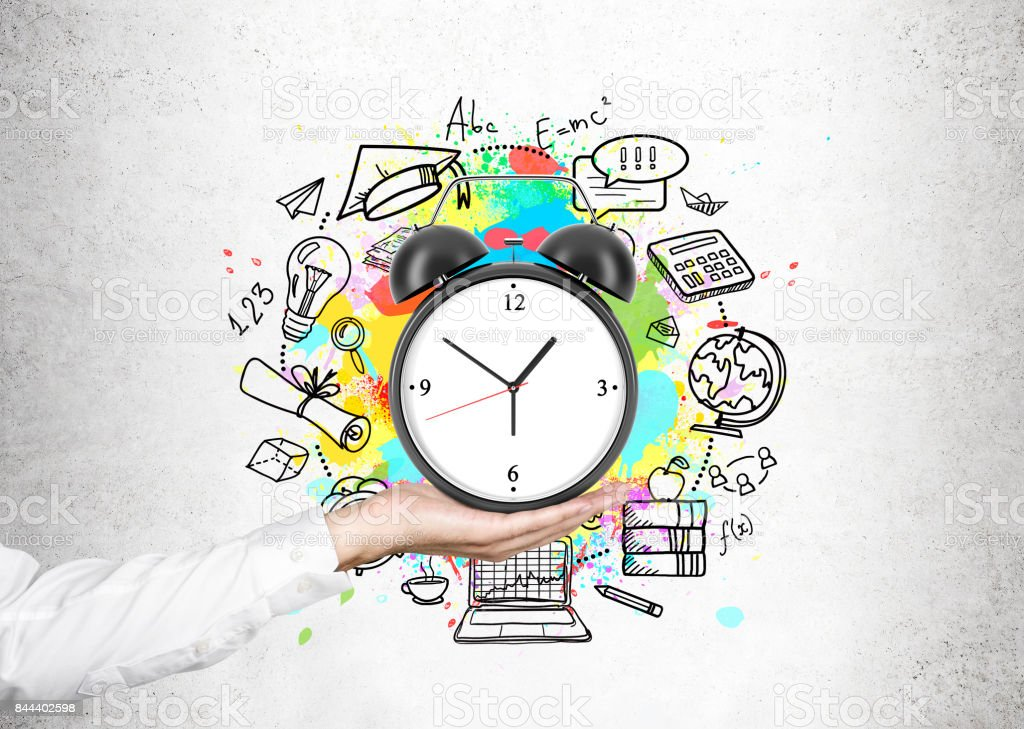 Man s hand and a time management scheme stock photo