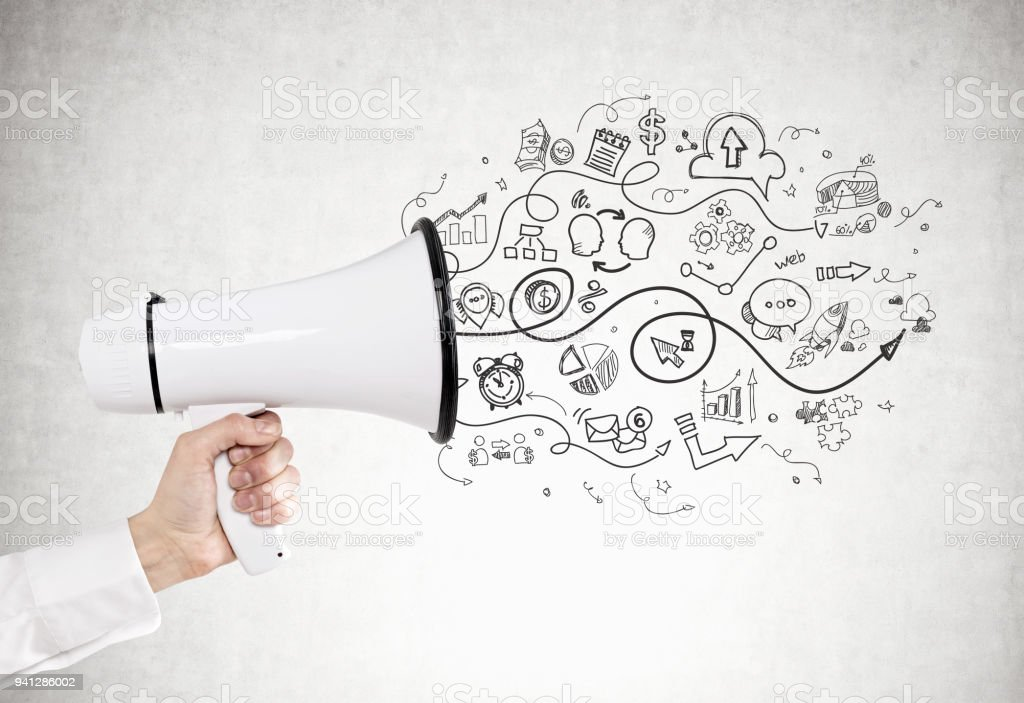 Man s hand with a megaphone, business strategy stock photo