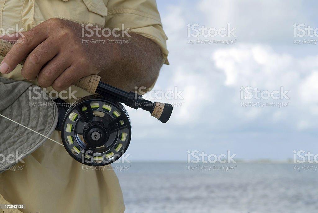 man salt water fly fishing stock photo