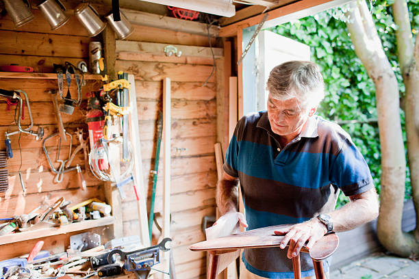 Man sanding wood in workshop  shed stock pictures, royalty-free photos & images