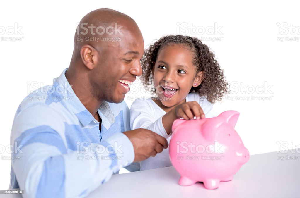 Man saving money with his daughter stock photo