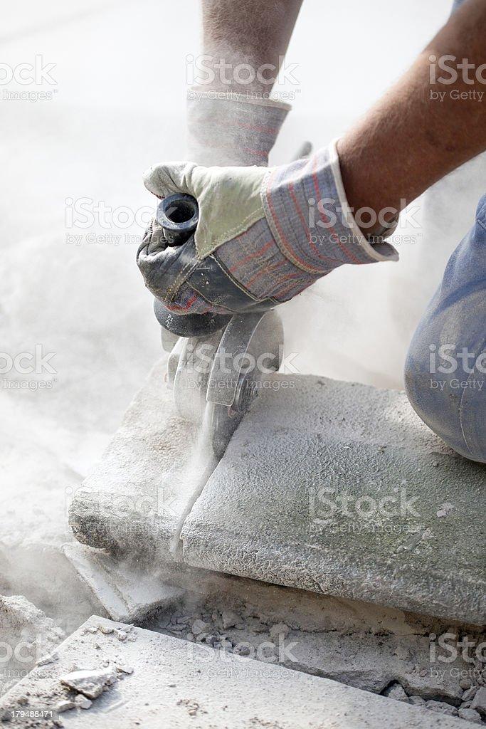 man sawin stone grinder stock photo