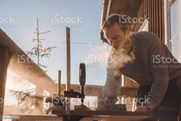 Man sawing wood for home improvement carpentry outdoors in cold picture id914980222?b=1&k=6&m=914980222&s=612x612&h=ost1ordswbqvmvt8vyyk33e8jezcethk7uk uclsrqy=