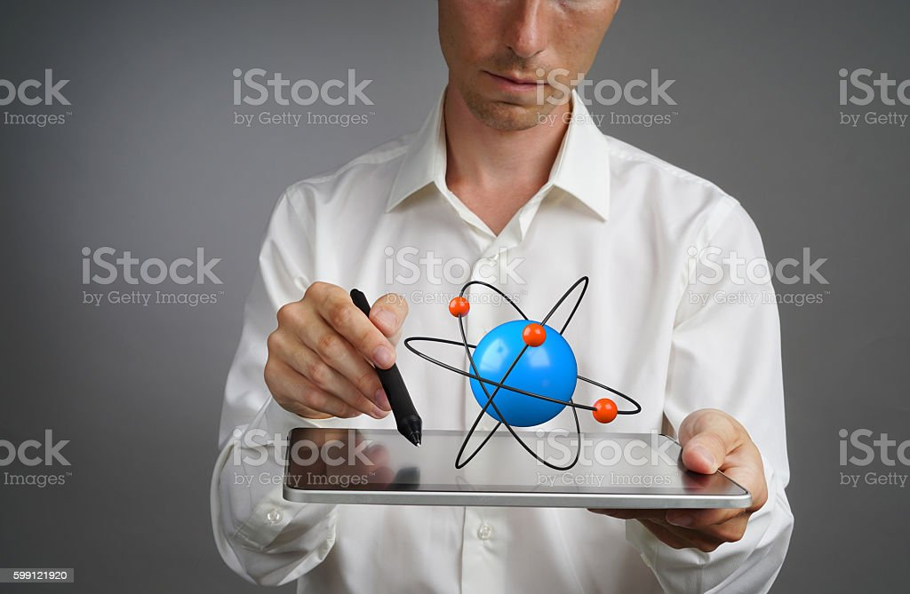 Man scientist holding a tablet PC with atom model, research stock photo