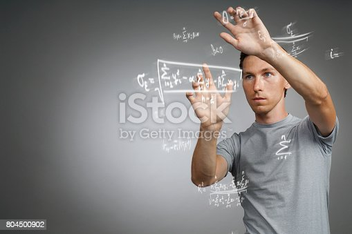 649719220 istock photo Man scientist or student working with various high school maths and science formulas 804500902