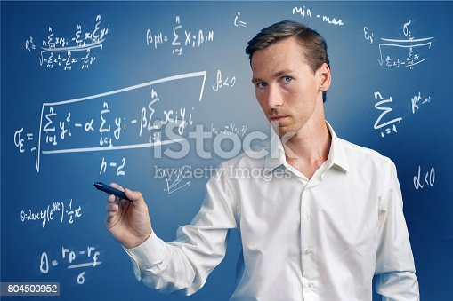 istock Man scientist or student working with various high school maths and science formulas 804500952