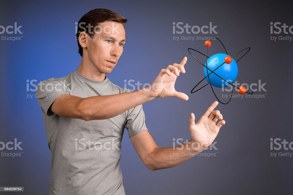 Man scientist with atom model, research concept stock photo