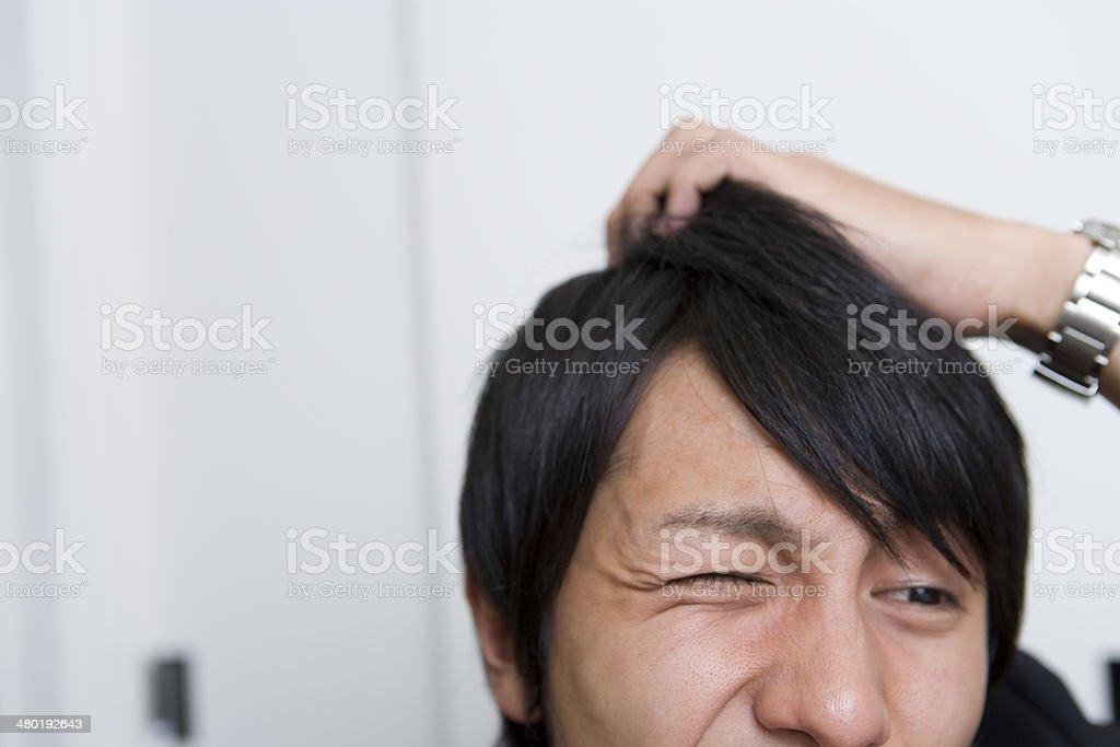 Man scratching head Man scratching head 20-29 Years Stock Photo