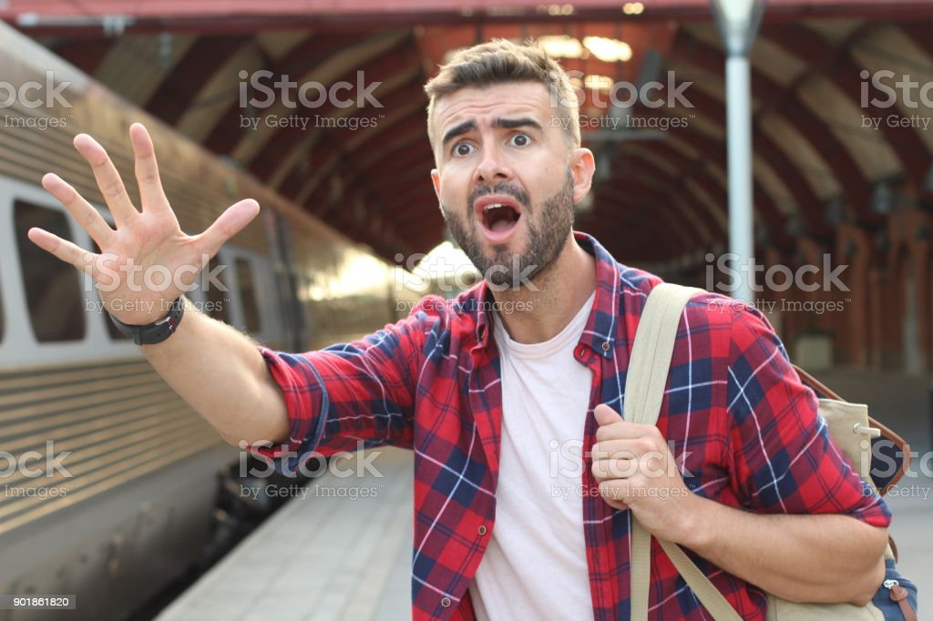 Man screaming after losing his train stock photo