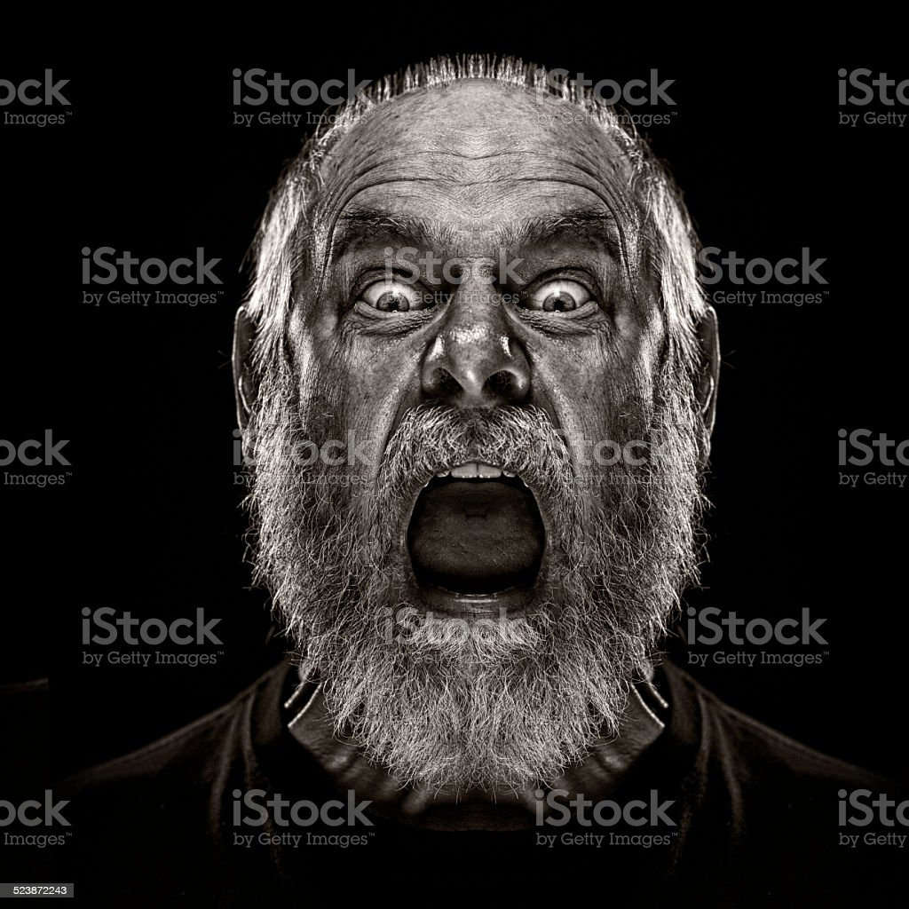 Man Screaming and looking terrified stock photo
