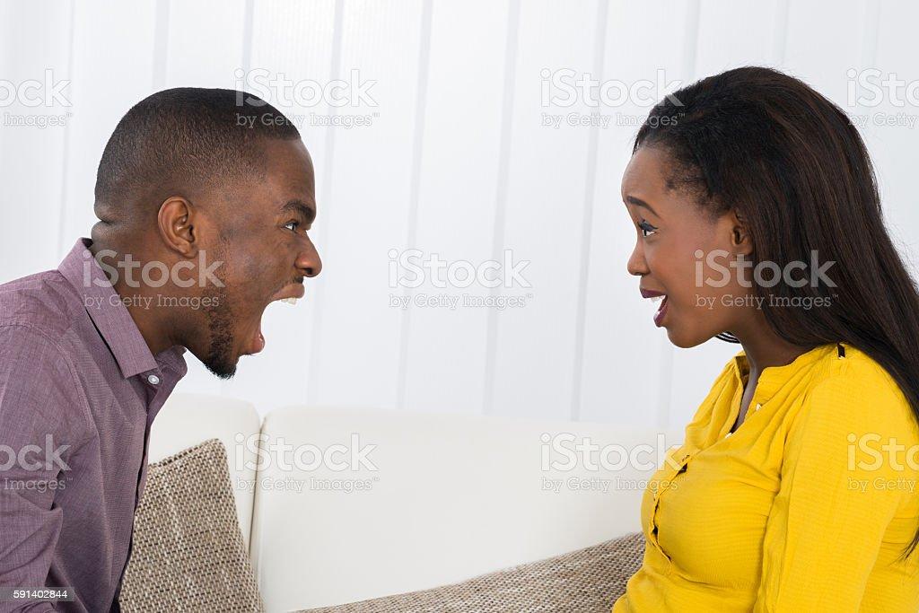 Man Screaming At Woman stock photo