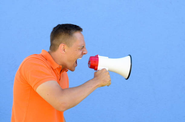 man screaming through the megaphone - loudon stock photos and pictures
