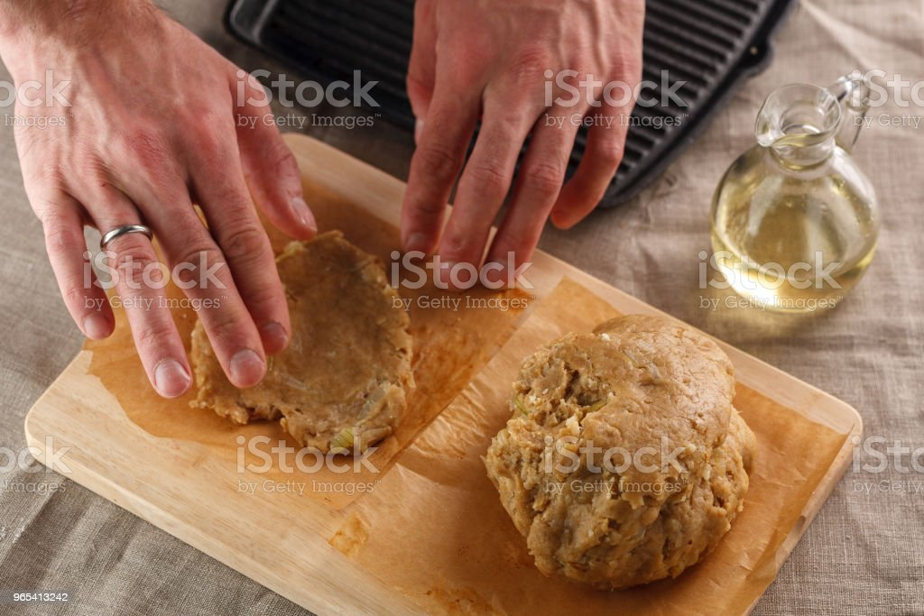 man sculpts hands dough for flat bread on the background of the grill royalty-free stock photo