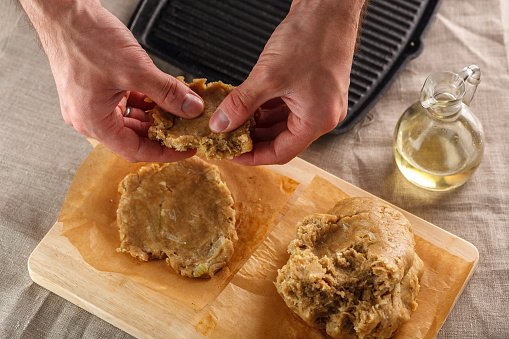 Man Sculpts Hands Dough For Flat Bread On The Background Of The Grill Stock Photo & More Pictures of Adult