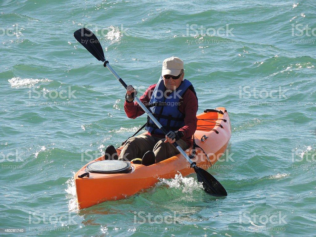 Man Sea Kayaking stock photo