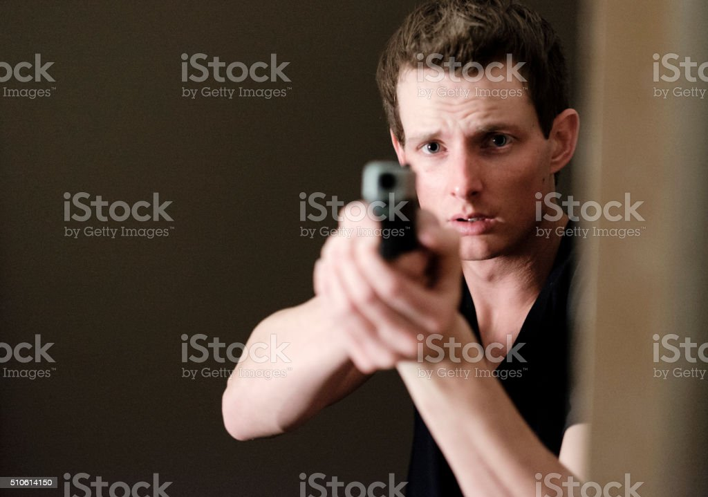 Man Searching a Dark Room stock photo