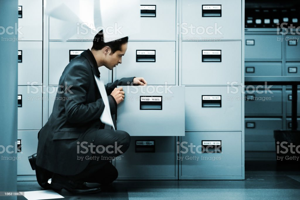 Man searching documents stock photo