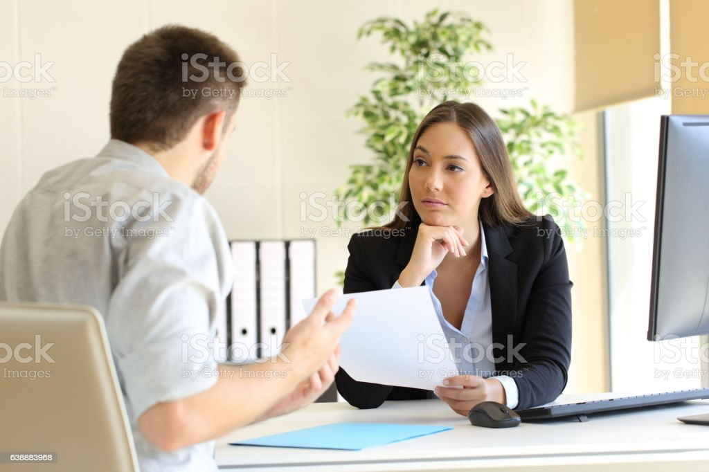 Man searching employment in a bad job interview stock photo