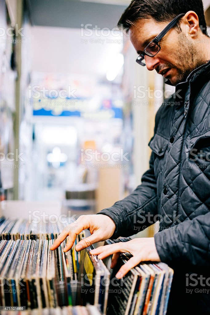Man searching for second hand vinyl records, record store stock photo