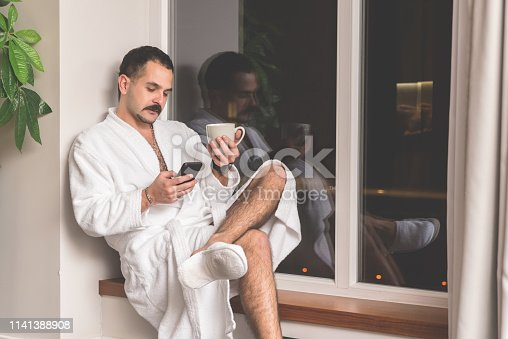 istock Man searching online on his smart phone 1141388908