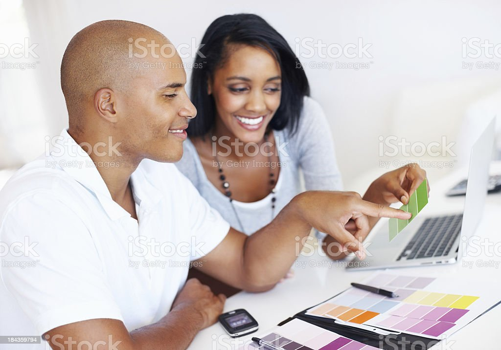 Man selecting color swatches with woman royalty-free stock photo