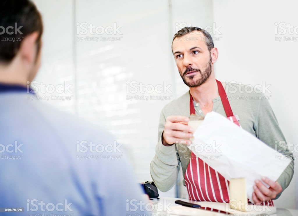 Man selling dairy products royalty-free stock photo