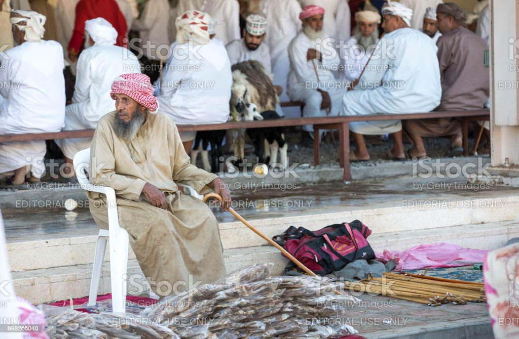 man selling dry fish at a market in Sinaw stock photo