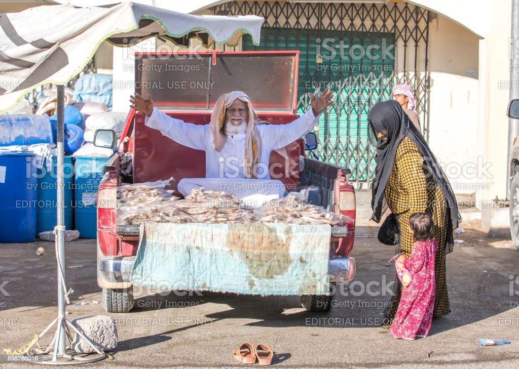 man selling fish at a market stock photo