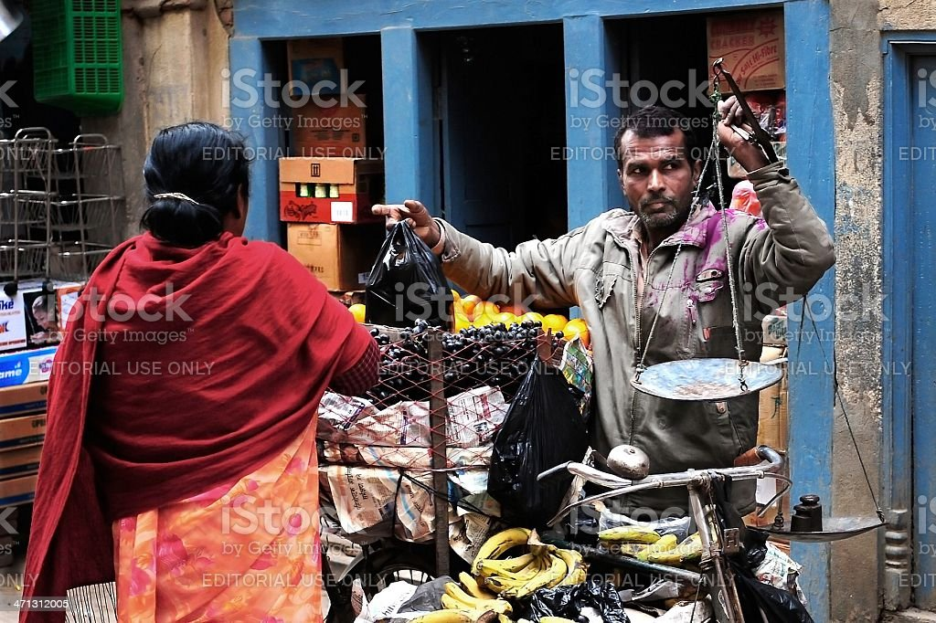 Man selling fruits on the street royalty-free stock photo