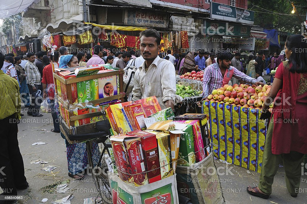 Man selling incense stick on the street in New Delhi royalty-free stock photo