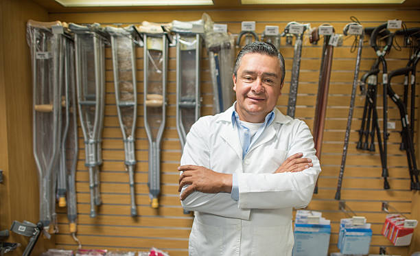 man selling orthopedics equipment - medical supplies stock photos and pictures