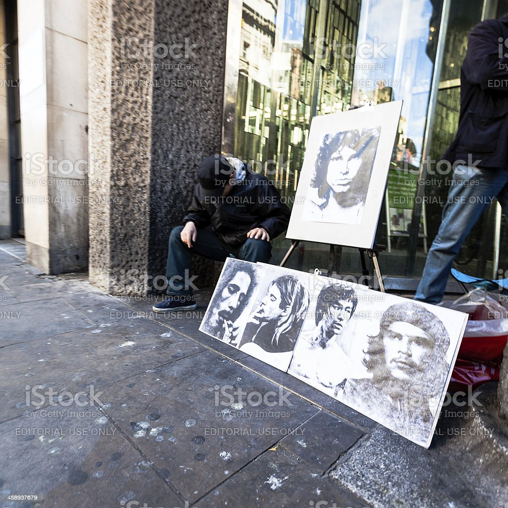 Man selling portraits of famous people royalty-free stock photo