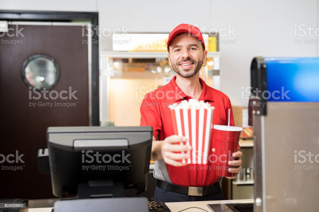 Man selling snacks at the movie theater stock photo