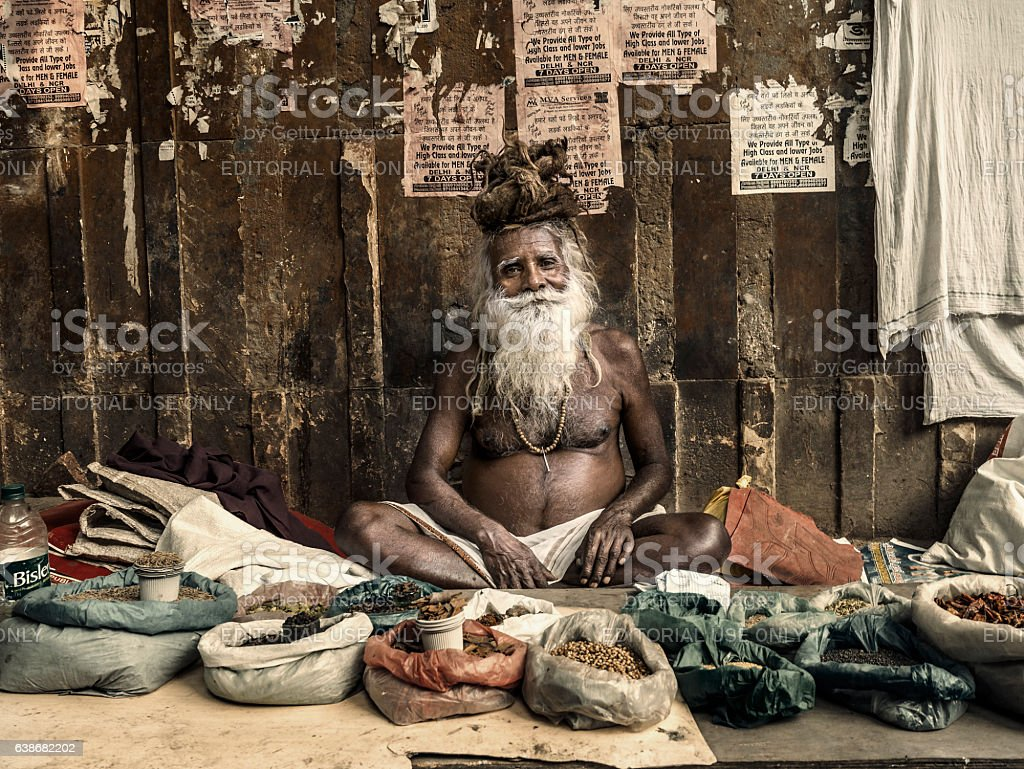 Man selling spices and dried food in street market stock photo