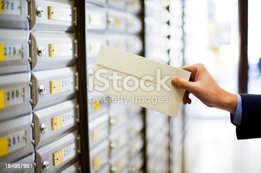 istock Man sending a letter 184957661