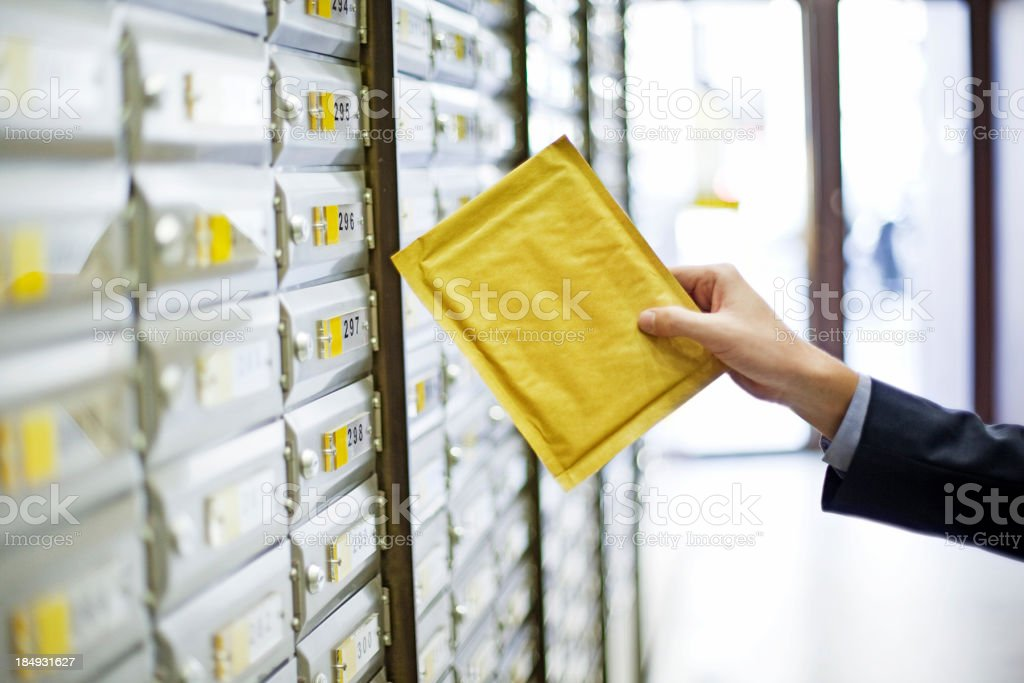 Man sending a package stock photo