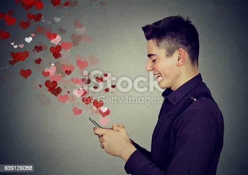 istock man sending love messages on mobile phone hearts flying away 639126088