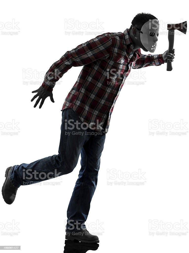 man serial killer with mask silhouette full length stock photo