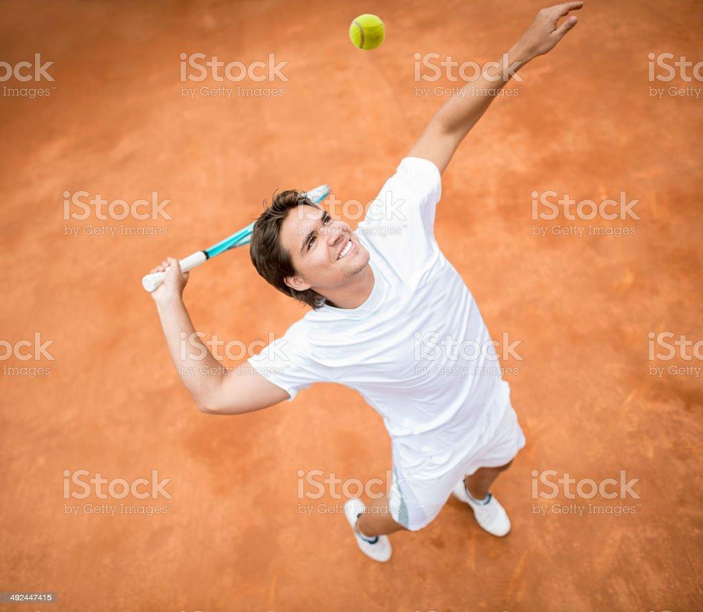 Man serving at tennis stock photo