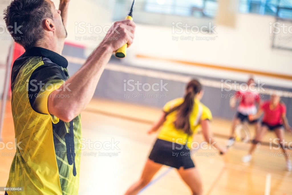 Man serving shuttlecock stock photo