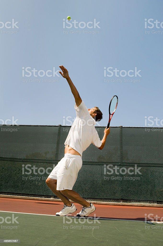 Man Serving Tennis Ball stock photo