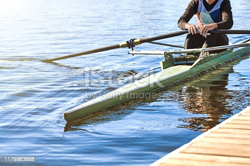 A man sets sail from the pier in a sports single canoe for training.