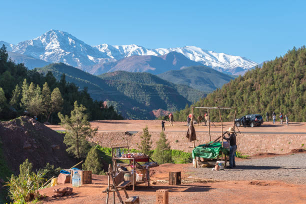 Man setting up a stall in High Atlas Mountains stock photo