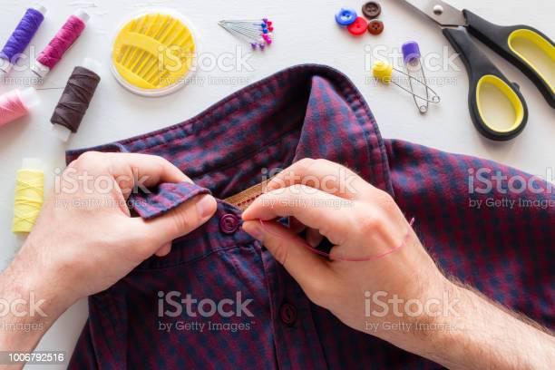 Man sews a button picture id1006792516?b=1&k=6&m=1006792516&s=612x612&h=nfrmi7ijnqckbojv3qbohi37liymtd0r9l7iaksakos=