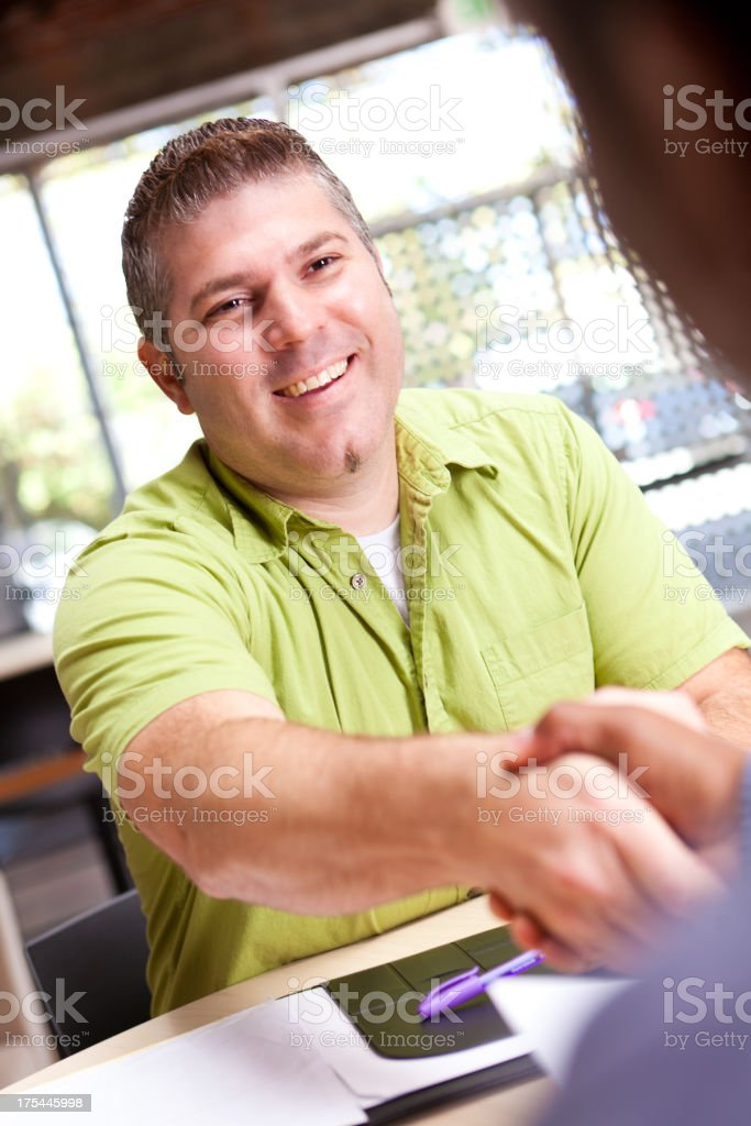 Man shaking hands with client royalty-free stock photo